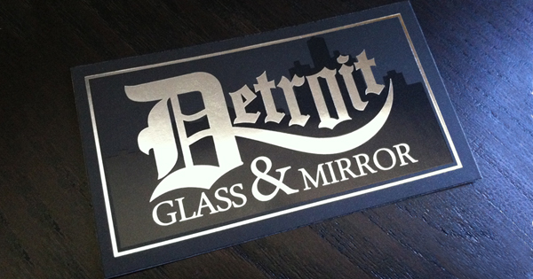 Detroit glass mirror business card steelfish design plymouth branding business card design for client in detroit michigan city effect achieved by aplying a gloss coat on a satin black card colourmoves